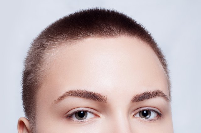 Face Young Woman With Buzz Cut