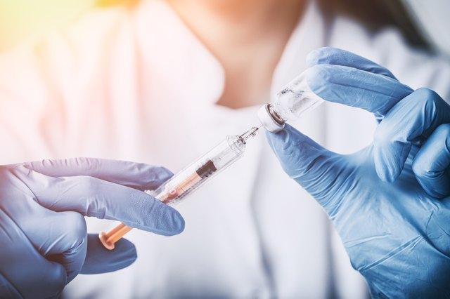 Nurse prepares injection