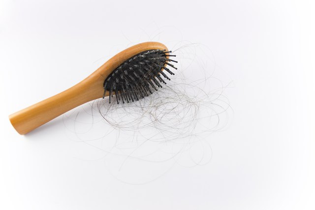 Hairbrush with strands of hair stuck in it