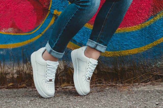 White Sneakers On Girl Legs The Graffiti Background