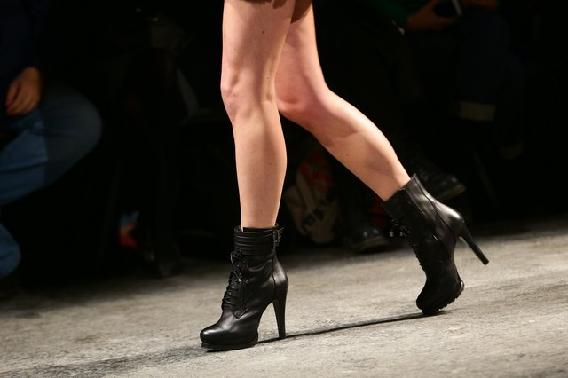 Model's bare legs on runway