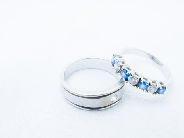 white diamond and blue gemstones on white gold rings