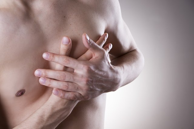 Man's chest closeup with hands