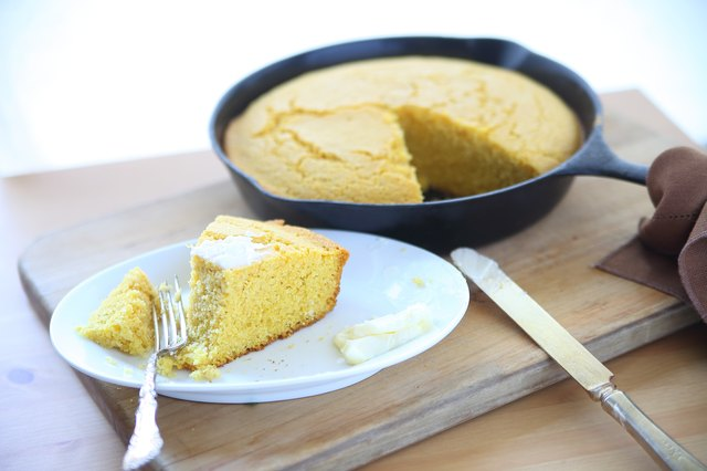 Cornbread in iron skillet, piece served