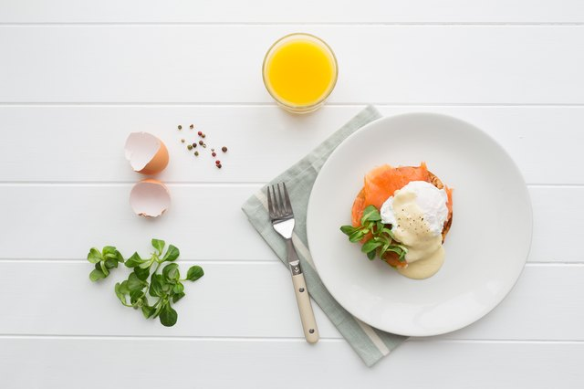 Breakfast with poached eggs royale and orange juice