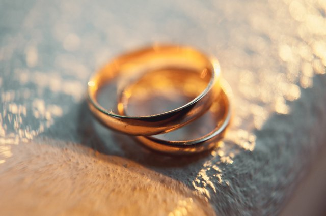 Gold Anniversary rings on a white background
