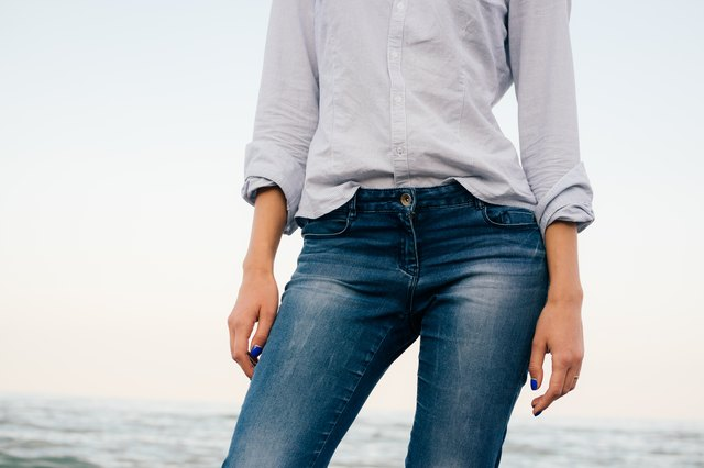 Woman in a striped shirt and blue jeans
