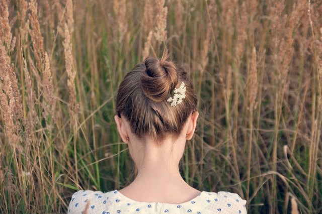 Back view of young woman with hair up