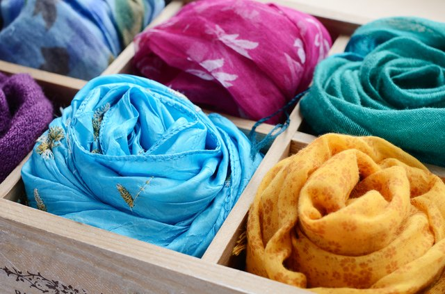 Set of colorful scarves in wooden box