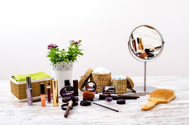 Make-up spread over a vanity with a mirror