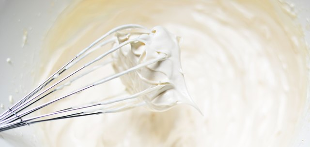 Whipping cream with a whisk close up