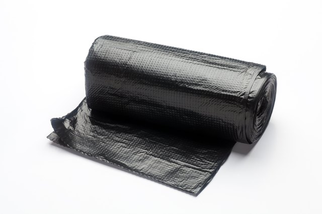 Roll of black plastic trash bags