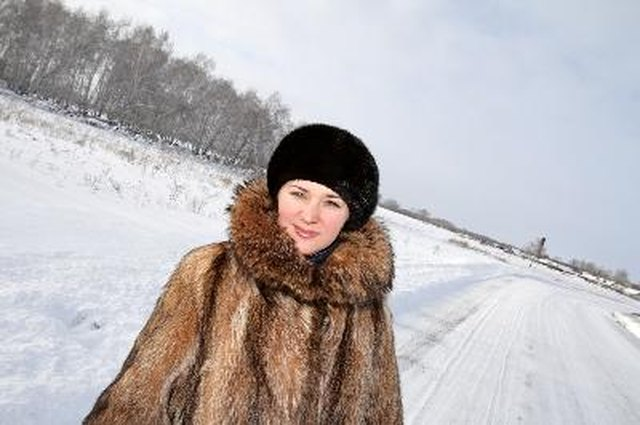 The woman walking on the winter road