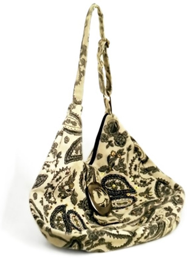 Stone Mountain Handbags Are Constructed From Leather And Fabric