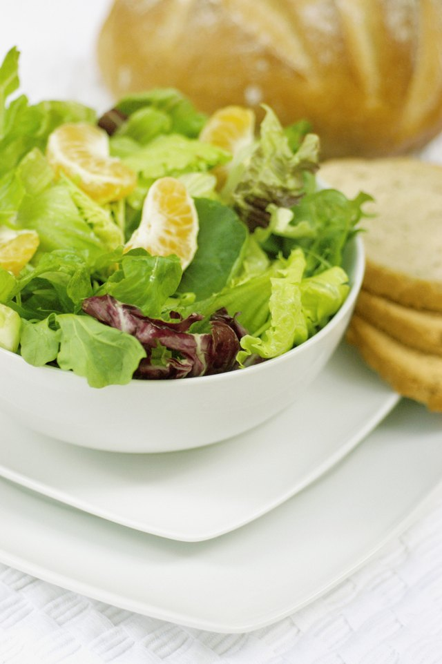 Close-up of a bowl of salad with slices of bread