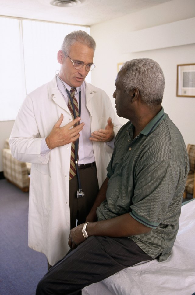 Male doctor talking to a male patient