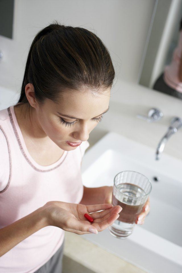 Young Woman Taking Medication