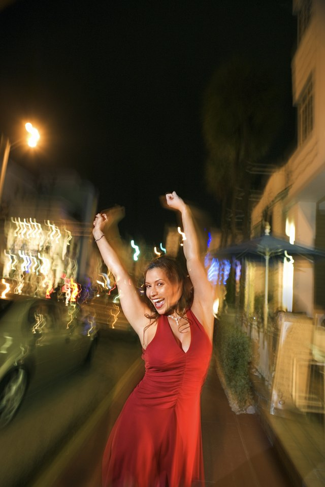 Woman outdoors at night showing excitement
