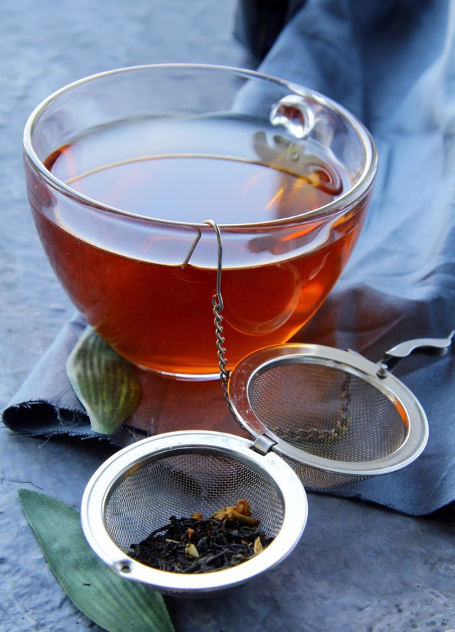 strainer with a fragrant black tea