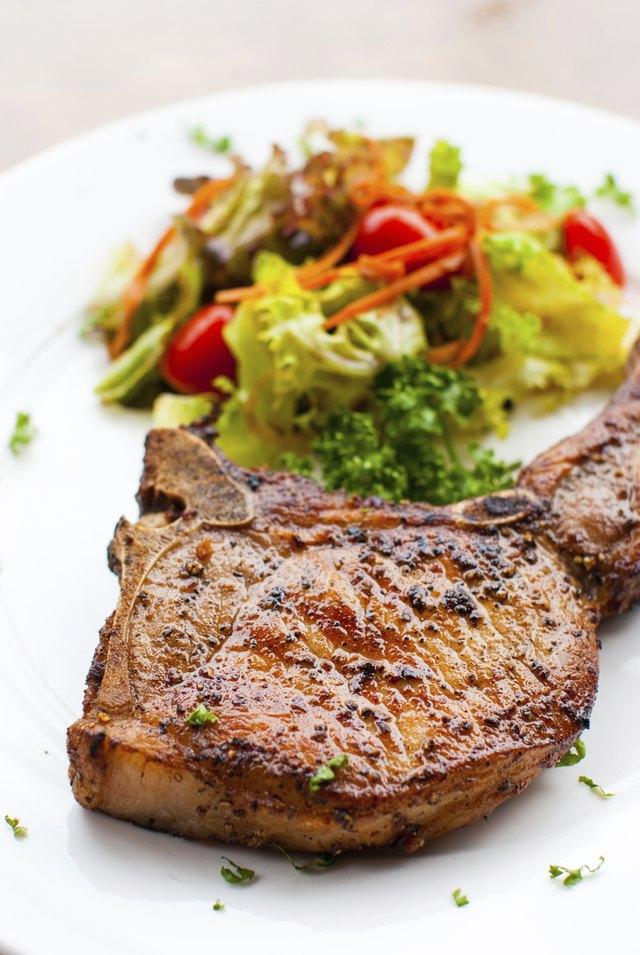 Pork chop with salad close up