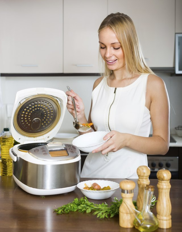 Woman cooking with multicooker