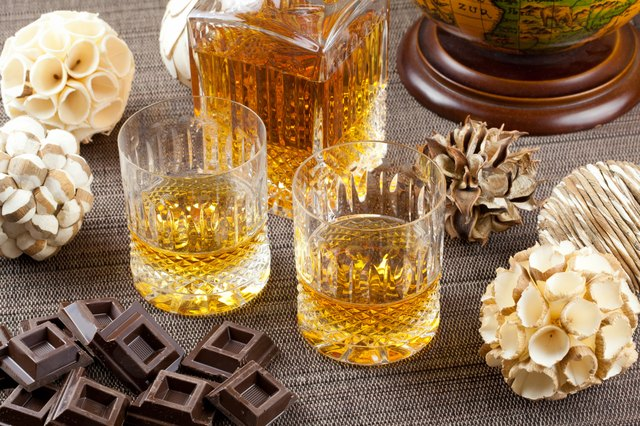 Chocolate and fine scotch whisky in crystal tumblers