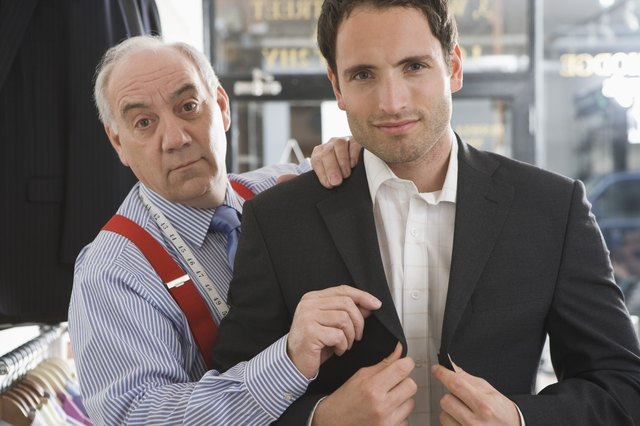 Tailor and customer with suit jacket