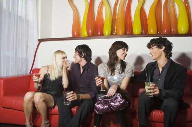 Friends sitting on sofa in nightclub