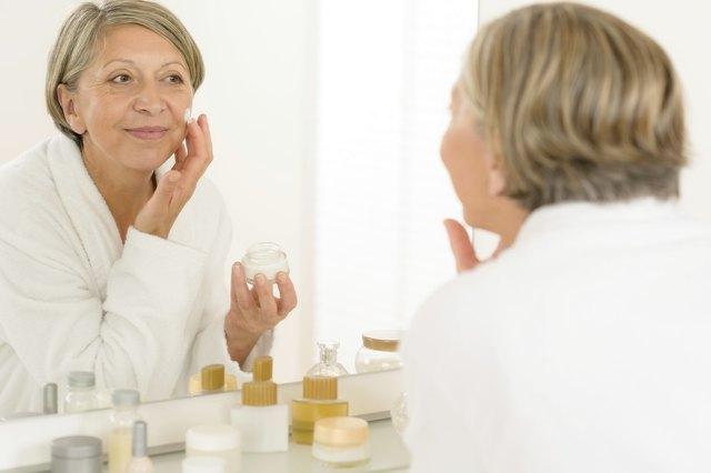 Senior woman reflection in bathroom mirror