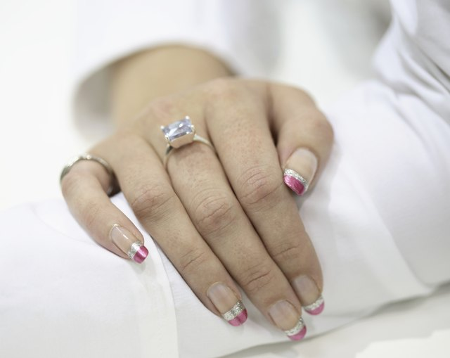 Female hand with diamond ring and nails