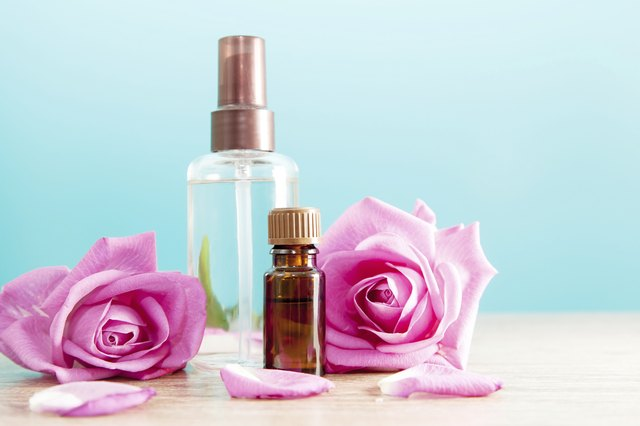 Bottle with aromatic oil and pink rose