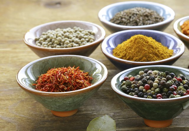 different kinds of spices in ceramic bowls