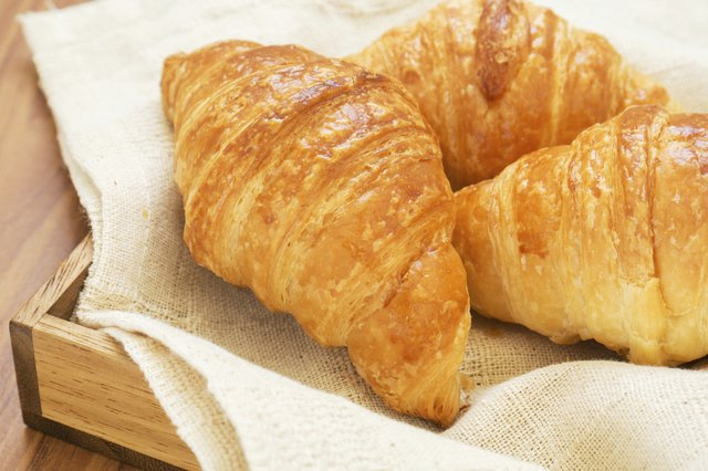 Croissants on wooden tray