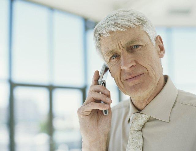 Senior businessman using mobile phone,portrait,close-up