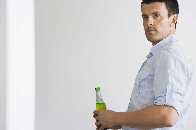 Man with beer bottle