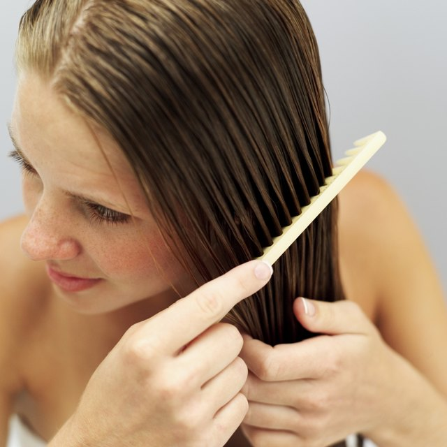 close-up of a woman combing her hair