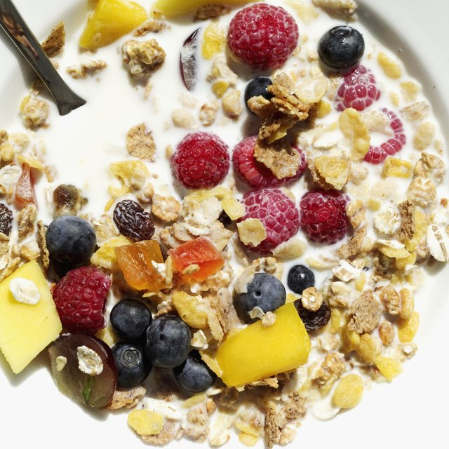 Close-up of cereal and assorted fruit in a bowl of milk