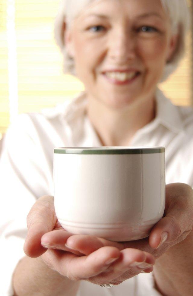 Smiling woman with mug of coffee