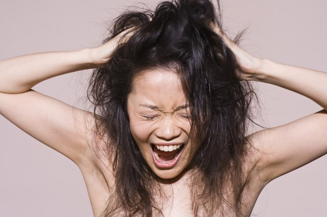 Woman screaming with messy hair