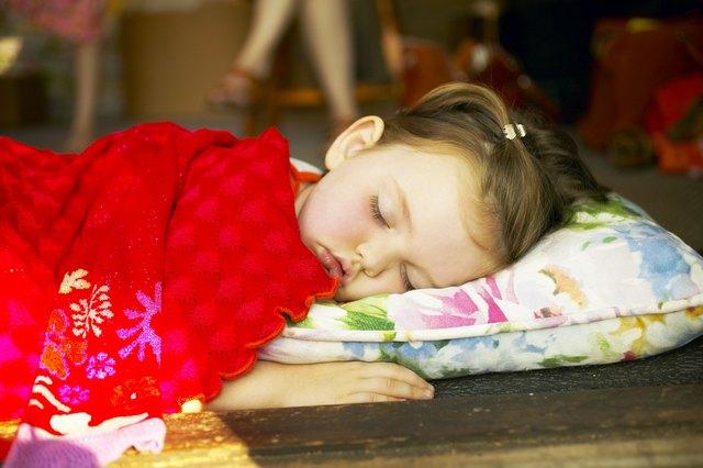 Toddler sleeping in doorway
