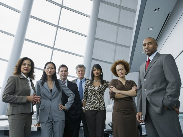 Multi-ethnic businesspeople in conference room