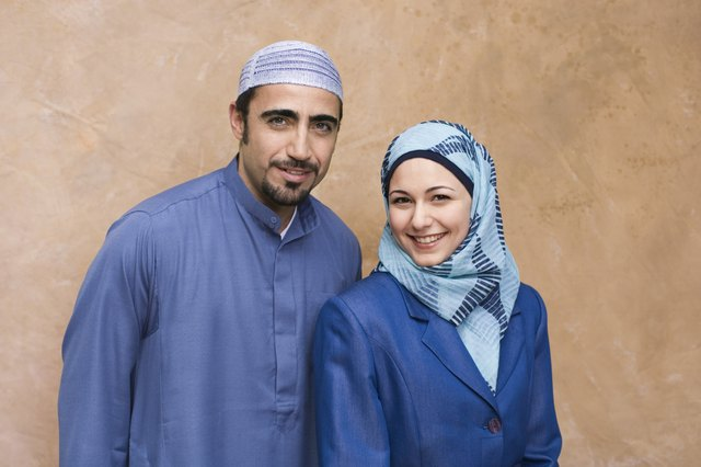 Turkish man wearing thobe and Iranian Persian woman wearing hijab headscarf