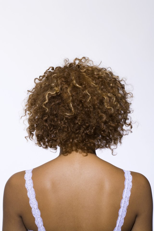 Back view of woman with curly hair