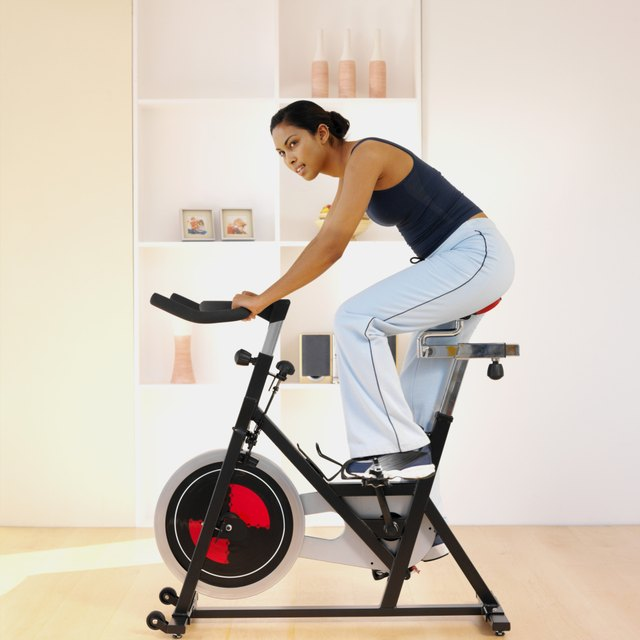 Woman working out on an exercise bike at home