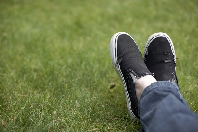 Foot in canvas shoe on grass