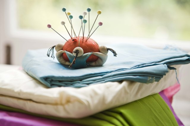 Pincushion and straight pins on fabric