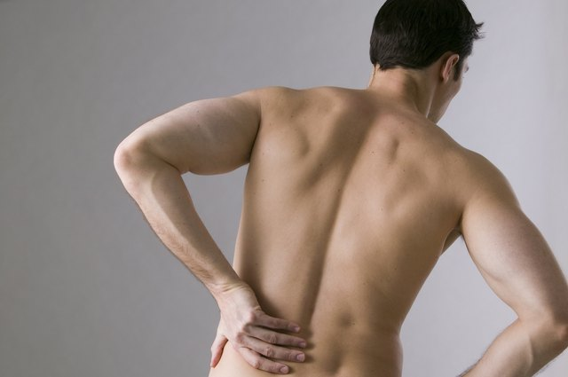 Man grasping his back in pain