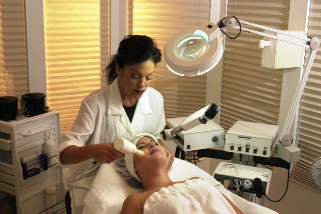 Woman getting facial from dermatologist