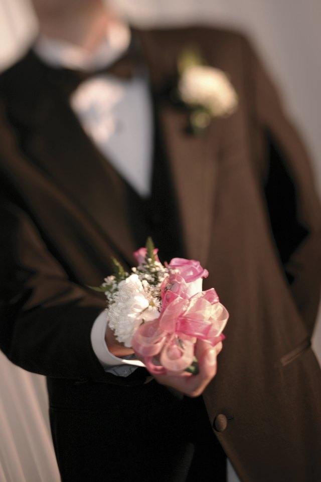 Man holding corsage