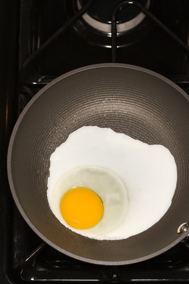 Egg cooking in frying pan